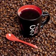 Cup of coffee with coffee beans — Stock Photo #5759237