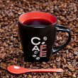 Cup of coffee with coffee beans — Stock Photo #5759250