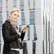 Portrait of young businesswoman with a mobile — Stock Photo #5759618