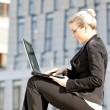 Sitting young businesswoman with a notebook — Stock Photo #5759631