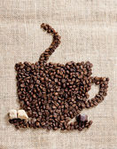 Cup of coffee made of coffee beans with sugar and chocolate — Stock Photo