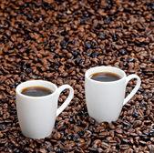 Still life di tazze di caffè e chicchi di caffè — Foto Stock