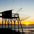 Stock Photo: Pier with fishing net during sunrise, Gironde Department, Aquita