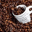 Cup of coffee with coffee beans — Stock Photo #5895364