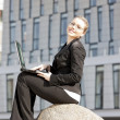 Stock Photo: Sitting young businesswoman with a notebook