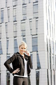 Portrait of telephoning young businesswoman — Stock Photo