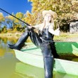 Stock Photo: Fishing woman sitting on boat