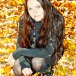 Portrait of young woman in autumnal nature — Stock Photo