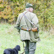 Hunter with his dog hunting — Stock Photo
