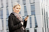 Portrait of young businesswoman with a mobile — Stock Photo