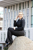 Telephoning young businesswoman — Stock Photo