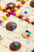Still life of white chocolate with smarties — Stock Photo