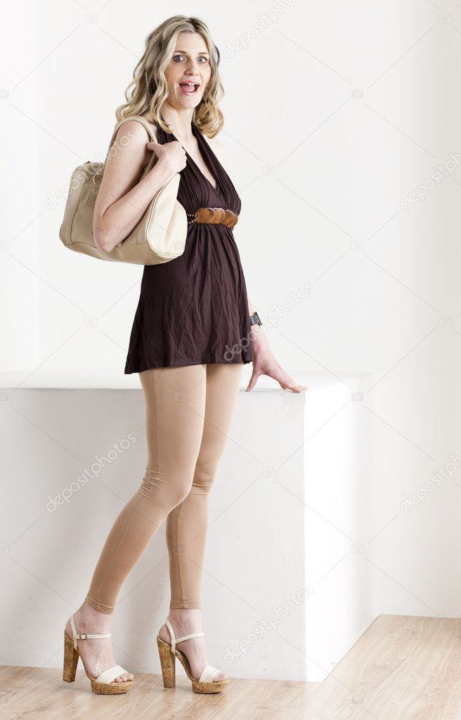 Standing woman wearing summer clothes and shoes with a handbag — Stock Photo #5988690