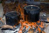 Kettles on fire — Stockfoto