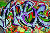 Graffiti on concrete wall — Stockfoto