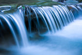 Blue cascade of mountain river — Stock Photo