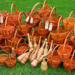 Woven baskets on green grass — Stockfoto