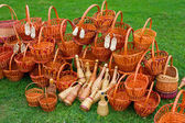 Woven baskets on green grass — Stok fotoğraf