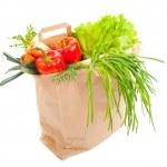 Grocery bag full of fresh vegetables — Stock Photo