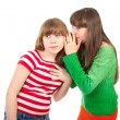 Foto Stock: Two school girls whisper
