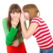 Two school girls whisper — Stock Photo