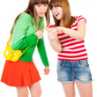 Two schoolgirls watching something in the mobile phone — Stock Photo #5477469