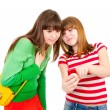 Two schoolgirls watching something in the mobile phone — Stock Photo