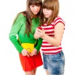 Two schoolgirls watching something in the mobile phone — Stock Photo #5477474