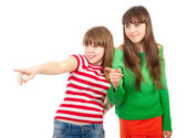 CGirls show at someone and giggle — Stock Photo