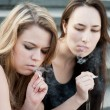 Two sad young girls smoke — Stock Photo #5747846