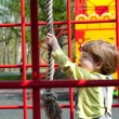Stock Photo: Boy having fun in playground