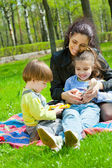 Mother with children resting — Stock Photo