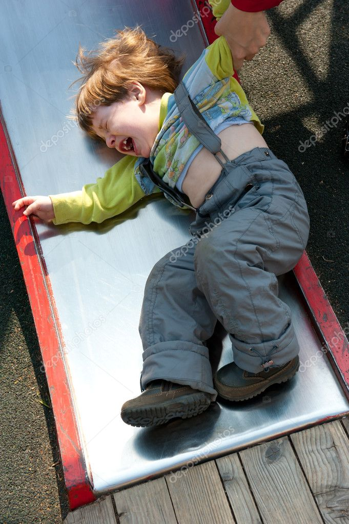 Stubborn naughty boy crying on the playground — Stock Photo #5755072