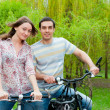 Royalty-Free Stock Photo: Happy young couple riding bicycles