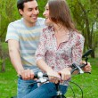Happy young couple riding bicycles — Stock Photo #5830857