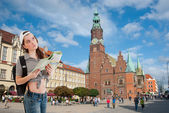 Tourist sightseeing with a map — Stock Photo