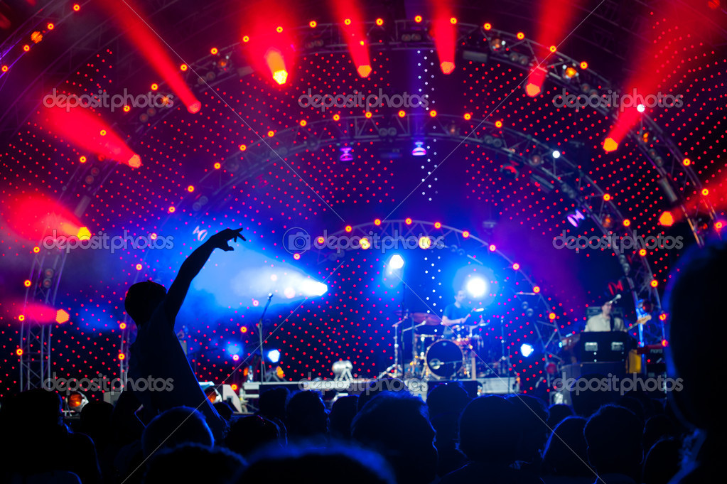 Crowd of fans at an open-air live concert — Stock Photo #5853279