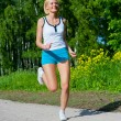 Woman running outdoor in a park — Stock Photo
