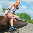 Roller blonde girl resting - Stock Photo
