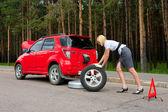 Blonde and broken car — Stock Photo