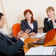 Stock Photo: Three business are meeting