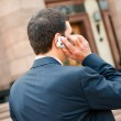 Young businessman calls on mobile — Stock Photo #6190316