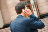 Young businessman calls on mobile — Stock Photo