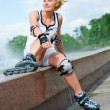 Stock Photo: Roller blonde girl resting