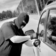 Thief breaks into a car door — Foto Stock