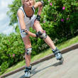 Stock Photo: Girl roller-skating in the park