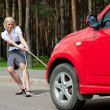 Blonde and broken car — Stock Photo #6224967
