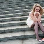 Sad lonely girl sitting — Stock Photo