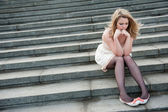 Sad lonely girl sitting — Stock Photo
