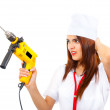 Mad nurse wants to drill you — Stock Photo